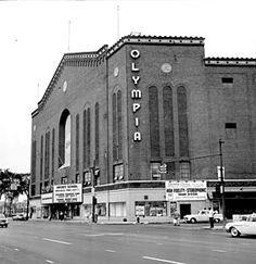 "Olympia: Nicknamed ""The Old Red Barn,"" Olympia Stadium stood at 5920 Grand River Ave. from 1927 until 1987. Shortly after opening, Olympia became the home of The Detroit Red Wings. In the 1950s, hockey fans packed the 15,000-seat stadium to watch Gordie Howe and the ""Production Line"" win four Stanley Cups."