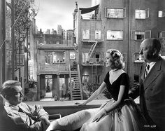 James Stewart, Grace Kelly and Alfred Hitchcock on the set of Rear Window