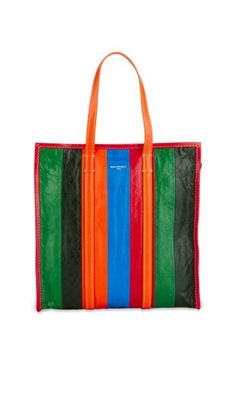 Inspired by the striped sampeng shopping bags seen in the markets of Thailand, Balenciaga's Bazar collection features the Bazar Striped Medium Shopper Bag. Bold and functional, this tote is crafted in Italy from smooth lambskin leather, and features a sequence of multi-colour Arena leather stripes in a structured shopper silhouette with slim top handles. The brand's emblematic logo is embossed in gold on the front, signalling its origins of high quality and style.