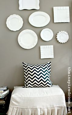 Pretty mismatched plates on a gray wall!