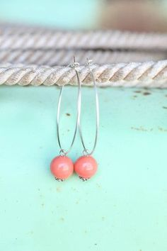 Pink Panache CORAL bead on large silver hoop earring.