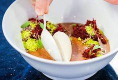 Velvet custard featuring Valrhona Manjari custard, Caraibe mousse, red (beet) velvet cake, Sicilian pistachio and cocoa nib gelato during Pastry Chef and Consultant Lincorln Carson