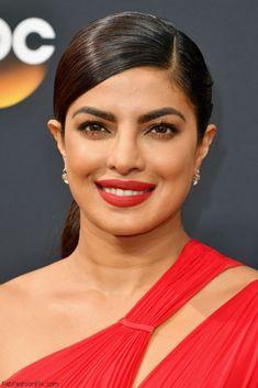 Gorgeous Priyanka Chopra wearing red lipstick and sleek ponytail at the 2016 Emmy Awards. #emmys #emmyawards #priyankachopra #makeup #redlipstick #redcarpet #fabfashionfix