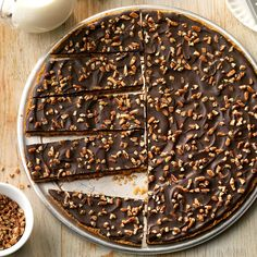 Chocolate Lover's Pizza Recipe -I created this after my dad said that my graham cracker crust should be topped with dark chocolate and pecans. It's easy to customize by adding your favorite chocolate and toppers. Dad thinks the whole world should know about this pizza! —Kathy Rairigh, Milford, Indiana