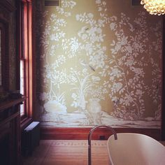 Dream bathroom in vintage eclectic modern brownstone.  A whole room with a soaking tub right in the middle!  Stunning chinoiserie wall paper is hand painted on linen.  280 Washington Brooklyn