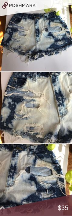 Wrangler bleached and distressed denim shorts M/L Wrangler Denim shorts that have been bleached and distressed. Medium/large. Perfect to wear with a leotard or tee! The cut outs in the shorts are wide, so these are best worn with something tucked in! Wrangler Shorts Jean Shorts