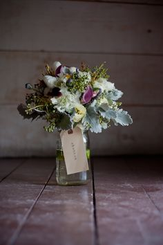 Vintage Style Country Wedding Bouquet - I love the presentation with the old school tag