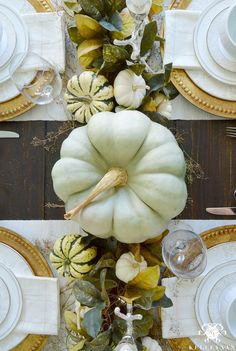 Fall and Thanksgiving table ideas! Check out all the details of this fall table with green magnolia garland and centerpiece green and white pumpkins- perfect table setting for your Thanksgiving tablescape!