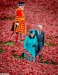 How beautiful! Queen Elizabeth II and Prince Philip, Duke of Edinburgh, visited the Blood Swept Lands and Seas of Red installation at the Tower of London on Thursday.