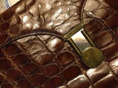 particular of real crocodile 50s brown clutch