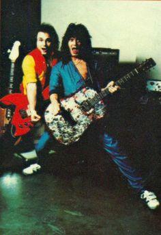 Eddie Van Halen goofing around with Michael Anthony strumming on David Lee Roth's bedazzled acoustic guitar