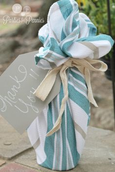 Hostess gift - dishtowel wrapped wine: Fill with (1) bottle Spin the Bottle Chardonnay and it's perfect!