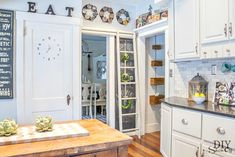 Eclectic Vintage Modern Farmhouse Kitchen Cookbooks over door reachable by ladder
