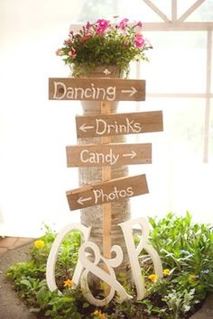 love this idea...easy...if the arrows are separate, the signs can be reused to fit wherever you have the drinks, desserts or whatever else at the next function...change the colors of the flowers and decor.