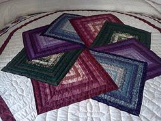 It's like mini quilts all twirling to make a big star thing...