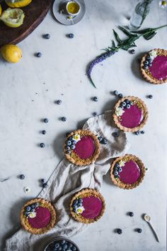 Blueberry Lemon Olive Oil Curd Tartlettes http://adventuresincooking.com/2017/04/blueberry-lemon-olive-oil-curd-tartlettes.html