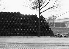 Christo and Jeanne-Claude | Projects | Stacked Oil Barrels and Dockside Packages