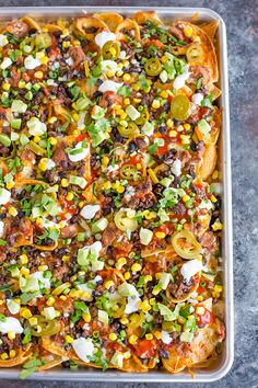A sheet pan full of loaded nachos. Leave out the corn.