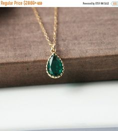 A pretty emerald green teardrop dangles on a gold filled chain. Simple and elegant and very eye catching, perfect as a layer necklace or on its