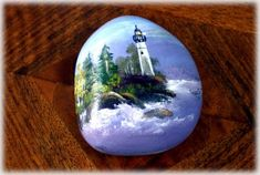 Lighthouse painting on rock. Image from Crystalpinecone.blogspot.com ... rock art
