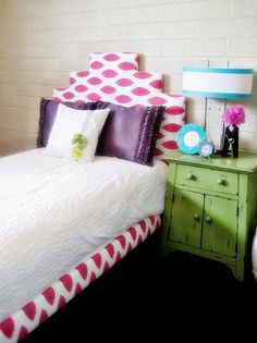 DIY upholstered headboard using an IKEA bed. Love how they covered the bed frame too with fabric. No need for a bed skirt!