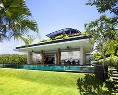 #Luxurious Green Meera House Guz Architects the well know Architect also designesd this Meera House. The Meera House is located on the island of Sentosa adjacent to Singapore and amazes with its magnificence. Looking from above, the house is like a green oasis, because roof and terraces are covered with grass and some trees. Beautiful view of the water, the incredible staircase and swimming pool separated by glass walls are also impressed by their originality.