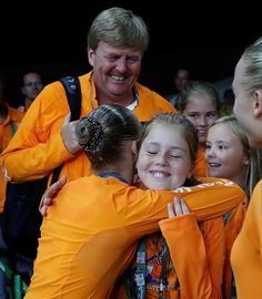 (L-R) King Willem-Alexander with his children Crown Princess Catharina-Amalia, Princess Alexia and Princess Ariane of the Netherlands congratulate Netherlands' Sanne Wevers on winning the women's balance beam event final of the Artistic Gymnastics at the Olympic Arena during the Rio 2016 Olympic Games in Rio de Janeiro on August 15, 2016.