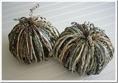 paper pumpkins - these are great! ...and even tho she used scrap book paper, i'm pretty sure just old newspaper would work too if you want a black & white look
