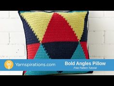 Graphic designs are a great way to incorporate color into your home - this triangular pillow is crocheted in four bright shades of Bernat Super Value, for ma...