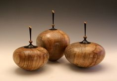 Curly Elm hollow forms, by Keith E. Burns. Finials are Blackwood.