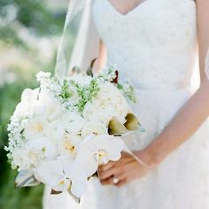 Wedding Wednesday continues with this detail shot of Micaela's bouquet with ranunculus, lilacs, orchids, and garden roses.  Floral: Lilla Bello  Planner: Cassandra Santor Events Photographer: Amy & Stuart  Location: Ojai Resort