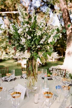 Centerpieces of lilies and delphinium branches decorated each table.