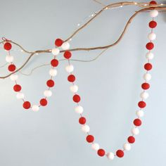 Red and White Felt Pom Pom Garland for £8.00 at www.lisaangel.co.uk