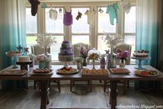Aqua and Lavender Shabby Chic Baby Shower - love the clothesline or itty bitty baby clothes!