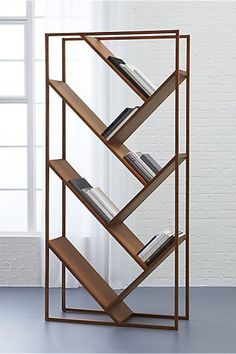 15 Products That Will Make Your Tiny Space Feel HUGE  #refinery29  http://www.refinery29.com/best-space-saving-furniture#slide-14  A bookcase and a room divider? We'll take it! CB2 Bookcase x Room Divider, $699, available at CB2....