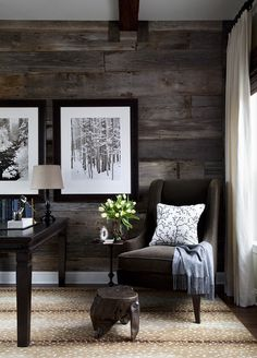 Great textures - love the dark wood wall, beautiful chair, carmel-y hued (sisal?) carpet and the large b/w prints are perfect. Lake home!