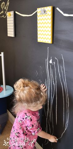 Love this chalkboard wall - perfect for a playroom!  (And the clipboard garland is cute, too!)