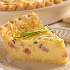 Quiche is a dish perfect for any meal of the day. A deep-dish pie shell filled with the delicious ingredients including savory ham, Swiss cheese and evaporated milk. Try the mini quiche variations as a starter to a meal or serve them alone as a snack. What's For Breakfast, Breakfast Dishes, Breakfast Recipes, Breakfast Quiche, Christmas Breakfast, Quiches, Quiche Lorraine, Ham And Swiss Quiche, Ham Quiche