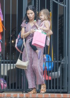 Mummy time:Jenna kept things casual and free-flowing in a stylish printed jumpsuit with a...