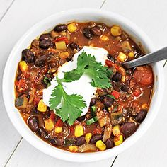Vegetarian Chili. I made this for a party where some friends were vegan (without the sour cream) and it was gone so fast. All 13 people loved it even the carnivores. I didn't have tomato sauce so I used two cans of tomatoes and also I used one can of red beans and one of black. Mmmmm