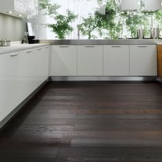 """interesting wood floors: called """"European Oak, fired to change colour to deep black."""" Note the unique plank placement."""