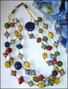 Paper and glass beaded necklace on Etsy