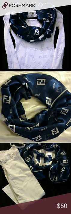 Fendi Scarf Dark Blue Fendi Scarf - Silk material - Fendi writing in white - Perfect for summer or winter - Looks great with an all white shirt ( as shown in pic 1) or with white pants as shown in pic 2. - New without tags Fendi Accessories Scarves & Wraps