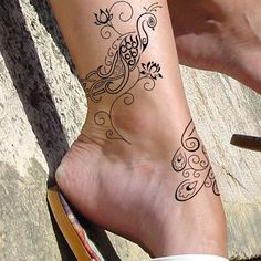 Love scroll tats... keeping it feminine & beautiful.. I am just now getting ready to get my 1st tat & this is the kind of style I am going for... I'm starting w/a wrap of stars like Rihanna's neck... LOVE! <3 L-