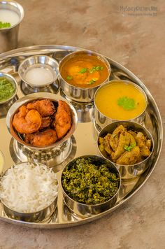 Maharashtrian Thali – Meal from Indian State of Maharashtra . Egg curry, Lentil stew (dhal), bottle gourd curry, spinach gram flour stir fry, shrimp fritters and creamy almond pudding are on the platter. Indian Snacks, Indian Food Recipes, Vegetarian Recipes, Cooking Recipes, Jain Recipes, Indian Appetizers, Rice Recipes, Cooking Tips, Veg Thali