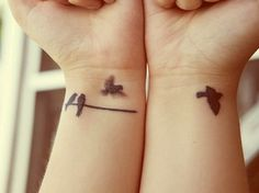 Bird tattoo to consider.  I like the 2 on the branch. Perhaps a Mommy and Daddy bird with baby birds for each kid?  aaah precious!