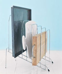 Desk organizer can hold kitchen items -Sort cookie sheets, cutting boards, and jelly-roll pans in the kitchen for easy access (and no more cymbal-crashing sounds) in an overstuffed cabinet. Organisation Hacks, Kitchen Organization, Kitchen Storage, Storage Organization, Cupboard Organizers, Organizing Tips, Organized Kitchen, Pantry Storage, Cupboard Storage