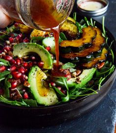 2 tablespoons coconut oil, acorn squash, sliced 1/2-inch thick,1/4 teaspoon salt 1/4 teaspoon pepper 2 teaspoons brown sugar, or coconut palm sugar 1/2 cup pecans, chopped 1/4 teaspoon pumpkin pie spice  6 cups baby arugula 1 avocado, sliced  1 pomegranate, 1 cucumber, sliced  Pomegranate Ginger Vinaigrette  1/3 cup pomegranate juice  1/4 cup apple cider vinegar  1/2 teaspoon grated ginger  1 garlic clove, grated  1/4 teaspoon salt  1/4 teaspoon pepper  1/3 cup olive oil extra virgin