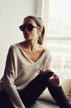 Yes to slouchy sweaters with open necklines worn with skinny jeans... Yes to the V...