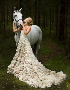 Somewhere out there... someone is wearing a pretty dress out in nature with a horse. Gosh, that is living! :)